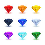 Set of bright shiny gemstone on white. Diamond, sapphire, ruby, emerald, and other. Royalty Free Stock Photo