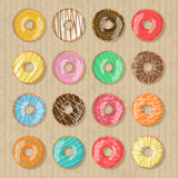 Set of 16 bright tasty vector donuts illustration on the cardboard box background. Doughnut icon in cartoon style for Stock Photo