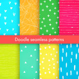 Set of bright vector doodle patterns. Set of bright vector doodle patterns with hearts, crosses, triangles, made of brush stroke. Blue, pink, yellow, orange Royalty Free Stock Photos