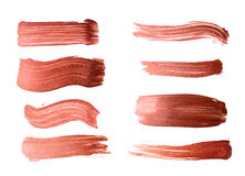Set of bronze brush strokes of acrylic paint as sample of art product Stock Photography