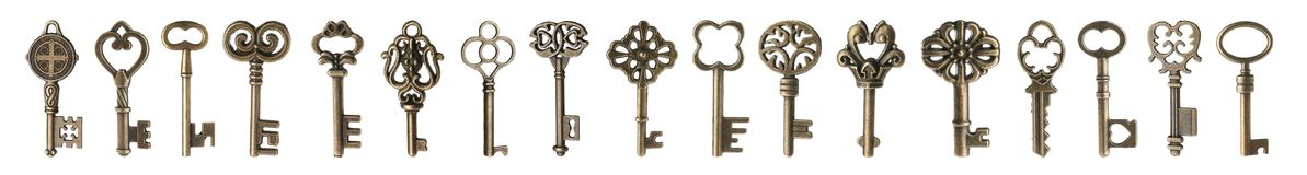 Set of bronze vintage ornate keys. On white background stock photos