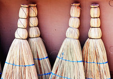 A set of brooms. In the market royalty free stock image