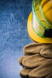 Set of brown construction leather gloves building helmet and pla Royalty Free Stock Photo