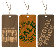 Set of brown crumpled paper tags. For sale, discount (nature style Royalty Free Stock Photos