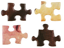 Set of brown little puzzle pieces Stock Image