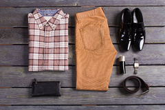 Set of brown men's clothing. Set of brown men's clothing and accessories Stock Photos