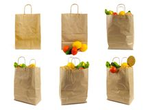 Set of Brown paper bag with vegetables. Recycled pack with fresh organic food isolated on white background.  stock photo