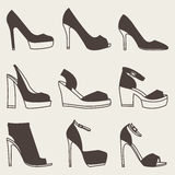 Set of brown shoes silhouettes on gray background. Collection of brown shoes silhouettes on gray background Stock Photos