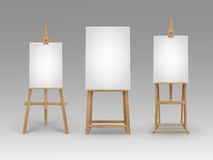 Set of Brown Wooden Easels with Blank Canvases Stock Photos