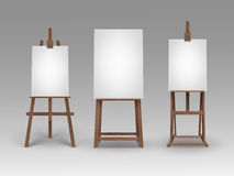 Set of Brown Wooden Easels with Mock Up Canvases Royalty Free Stock Photography