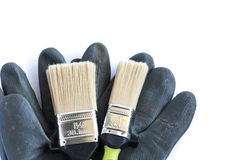 Set of brush and glove over a white background Stock Photos
