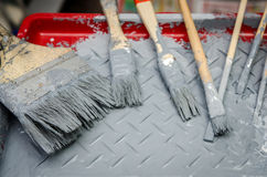 Set of brush  in red paint tray Royalty Free Stock Photos