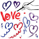 Set of brush strokes and scribbles in heart shapes Royalty Free Stock Images