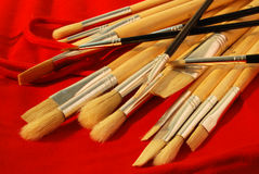 Set of Brushes. With wooden handle, on a red fabric stock image