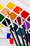 A set of brushes on the background of acrylic and watercolor. Back to school Stock Image