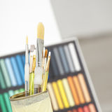 Set of brushes in a can. With colorful background Stock Images