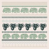 Set of brushes Indian Elephant with native zigzag ornaments ornamental strips. Hand drawn ethnic tribal decorated Elephant. dark o. Live green contour on Beige Royalty Free Stock Image