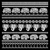 Set of brushes Indian Elephant with native zigzag ornaments ornamental strips. Hand drawn ethnic tribal decorated Elephant. White. Contour on Black background Royalty Free Stock Photos