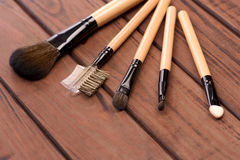 Set of brushes for makeup scattered chaotically Royalty Free Stock Images