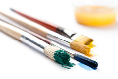 Set of brushes near the ink container Stock Image