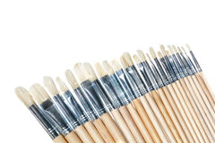 A set of brushes for painting in a row of artists. Stock Photos