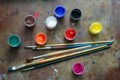 Set of brushes and paints Stock Photography