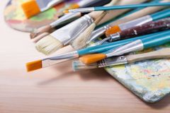 Set of brushes with palettes. Set of painters brushes on palette royalty free stock images