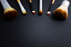 A set of brushes for professional makeup on a black background. Royalty Free Stock Photo