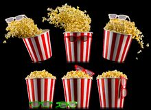 Set of buckets with popcorn and 3D glasses isolated on black background