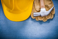 Set of building helmet claw hammer protective gloves constructio Stock Image