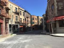 This is a set of a buildings  located on a studio lot simulating a historical town setting such as New York City where old movies. Are filmed stock image