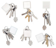 Set of bunch of door keys with blank keychain Royalty Free Stock Photo