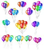 Set of bunches of colorful helium balloons with strings isolated on white background. Set of bunches of colorful helium balloons with strings isolated on white Royalty Free Stock Images