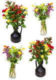 Set of bunches of flowers in jugs on white Royalty Free Stock Photos