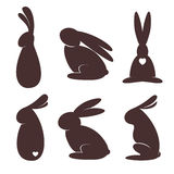 Set of bunnies. Six vector bunnies silhouettes on the white background Stock Image