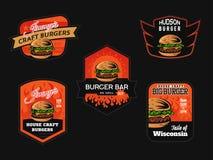 Set of burger shop logo, emblems and badges. Fast food design stock illustration
