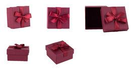 Set of burgundy gift boxes with bows and ribbons. Image photo Stock Image