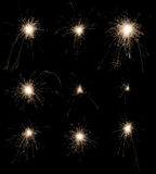 Set of burning sparklers on black background. Royalty Free Stock Photo