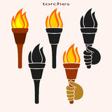 Set of burning torches Royalty Free Stock Photography