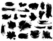 Set of bushy small black brushstrokes. Isolated on white background. Shaggy shapes and thin stripes Stock Photography