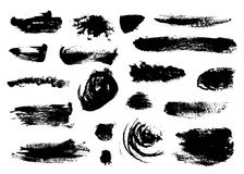 Set of bushy small black brushstrokes. Isolated on white background. Shaggy shapes, circles and thin stripes Stock Photography