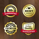 Set business gold premium label on wood  background. Set business gold label on wood  background.  from background. best product / premium quality tag Stock Photography