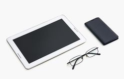 Tablet and glasses close-up shot from above stock photos
