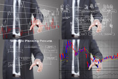 Set of Businessman pushing graph on the whiteboard Stock Photo