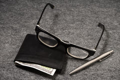 Set businessman. Silver pen, black purse on a old background. Stock Images