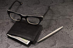 Set businessman. Silver pen, black purse on a old background. Royalty Free Stock Image