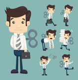 Set of businessman with wind-up key Royalty Free Stock Photography