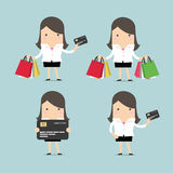 Set of businesswoman with credit card and shopping bags Stock Photos