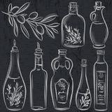 Set butelka dla oliwa z oliwek na blackboard Zdjęcia Royalty Free
