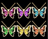 Set of butterfly pendants with precious stones. Illustration of a set of butterfly pendants with precious stones Royalty Free Stock Image